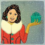 Elegant young and happy woman in winter, retro Christmas card Stock Photo