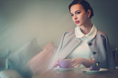 Elegant young lady alone in a cafe.  Royalty Free Stock Photo