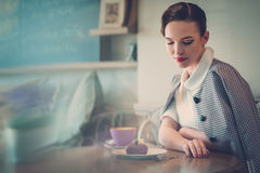 Elegant young lady alone in a cafe.  Stock Image