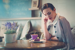 Elegant young lady alone in a cafe.  Stock Photography