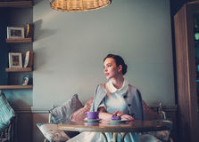 Elegant young lady alone in a cafe Stock Photography