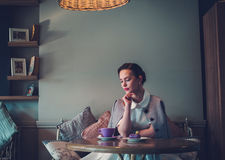 Elegant young lady alone in a cafe.  stock photos