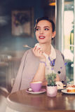 Elegant young lady alone in a cafe.  stock images