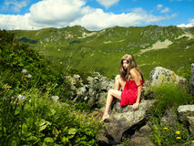 Elegant young lady in the mountains Royalty Free Stock Photos