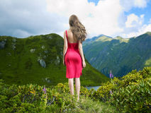 Elegant young lady in the mountains Royalty Free Stock Photography