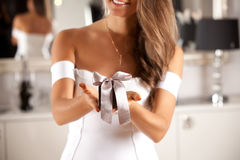 Elegant young lady in sexy white dress with gift box. Stock Photos