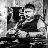 Elegant young man in barbershop. Black-white photo. stock photo