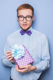 Elegant young man with colorful gift. Present, birthday, Valentine Stock Photos