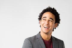 Elegant young man with curly hair laughing Stock Photos