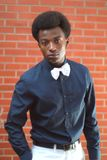 Elegant young man handsome look bow tie black shirt royalty free stock image