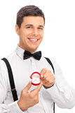 Elegant young man holding an engagement ring Royalty Free Stock Image
