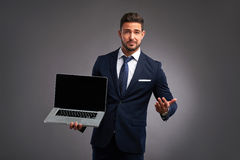 Elegant young man with laptop Stock Photo