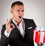 Elegant young man with present Royalty Free Stock Photography