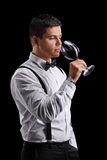 Elegant young man tasting red wine Royalty Free Stock Image