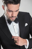 Elegant young man in tuxedo looking down Royalty Free Stock Photo
