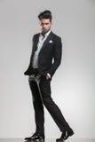 Elegant young man in tuxedo walking Royalty Free Stock Images
