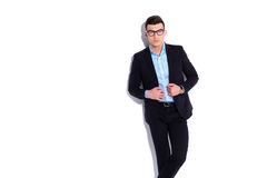 Elegant young man wearing glasses and suit holding collar Stock Image