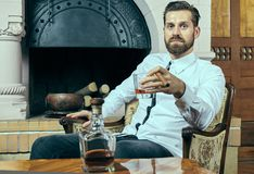 Elegant young man with whiskey and cigar Stock Images