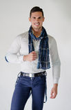 Elegant young man with white shirt and blue scarf, smiling Stock Photography