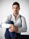 Elegant young man with white shirt and suspenders Stock Image