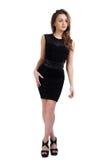 Elegant young model in black dress. Studio shot Stock Photography