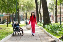 Elegant young Vietnamese woman in a park Royalty Free Stock Photos