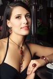 Elegant young woman in bar Stock Photo