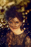 Elegant young woman in black lace dress and veil hat with long c Royalty Free Stock Photos