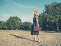 Elegant young woman with briefcase standing in park Royalty Free Stock Photos