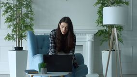 Elegant woman working on laptop pc and blogging stock video footage