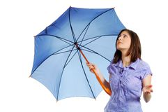 Elegant young woman checking if it's still raining. Isolated over a white background Stock Photography