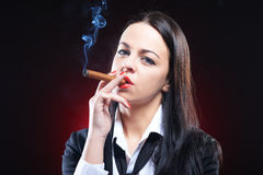 Elegant young woman with cigar Royalty Free Stock Image