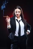 Elegant young woman with cigar Stock Images