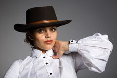 Elegant young woman in a cowboy hat. Stock Photos