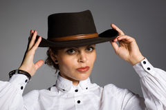 Elegant young woman in a cowboy hat. Royalty Free Stock Image