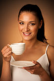 Elegant young woman with a cup of coffee Stock Images
