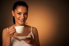 Elegant young woman with a cup of coffee Stock Photos