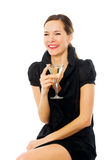 Elegant young woman drinking a cocktail Royalty Free Stock Photography