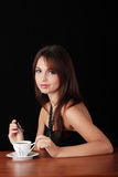 Elegant young woman drinking coffee Royalty Free Stock Image