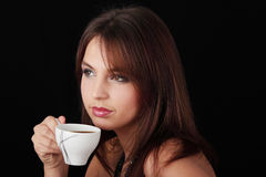 Elegant young woman drinking coffee Royalty Free Stock Images