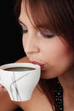 Elegant young woman drinking coffee Stock Photos