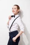 Elegant young woman holding her bow tie Stock Images