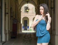 Elegant young woman next to gallery in european city Royalty Free Stock Photography