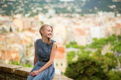 Elegant young woman in the Old town of Cannes Royalty Free Stock Photo