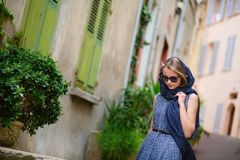 Elegant young woman in the Old town of Cannes Royalty Free Stock Photography