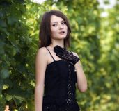 Elegant young woman outdoor portrait lean on wall covered in vin Royalty Free Stock Image