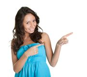 Elegant young woman pointing to the right Stock Images