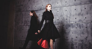 Elegant young woman posing in coat, fast-moving Royalty Free Stock Photography