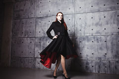 Elegant young woman posing in coat, hoto Studio Royalty Free Stock Photo