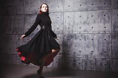 Elegant young woman posing in coat, hoto Studio Royalty Free Stock Image
